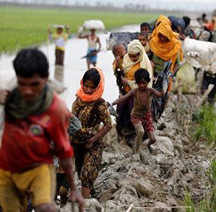 Члены этнических меньшинств в Мьянме, проживающие в Ричьяне, на границе с Бангладеш. 3 сентября 2017 года