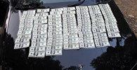 Изъятие фальшивых денег в Джалал-Абаде