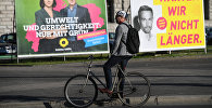 Предвыборная агитация на одной из улиц Берлина накануне парламентских выборов в Германии.
