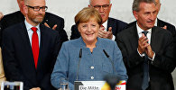 Действующий канцлер Германи Ангела Меркель во время озвучки первых результатов на выборах в бундестаг (парламент)