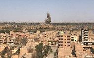 Вид на район Джафра в Дейр-эз-Зоре, где продолжаются бои между сирийской армией и боевиками запрещенной в России организации ИГИЛ.