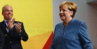 Германиядагы парламенттик шайлоодо канцлер Ангела Меркелдин блогу — Германиянын христиандык-демократиялык союзу добуштардын 33 пайызын алып, жеңишке жетти.