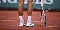 Теннисист во время матча, Архивное фото