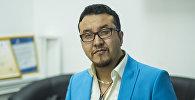 Москвада жашап, үй-бүлө күтүп, ишкерлик менен ийгиликтүү алектенген Азамат Адылгазиевдин архивдик сүрөтү