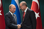 Президент РФ Владимир Путин и президент Турции Реджеп Тайип Эрдоган на пресс-конференции по итогам российско-турецких переговоров в Анкаре.