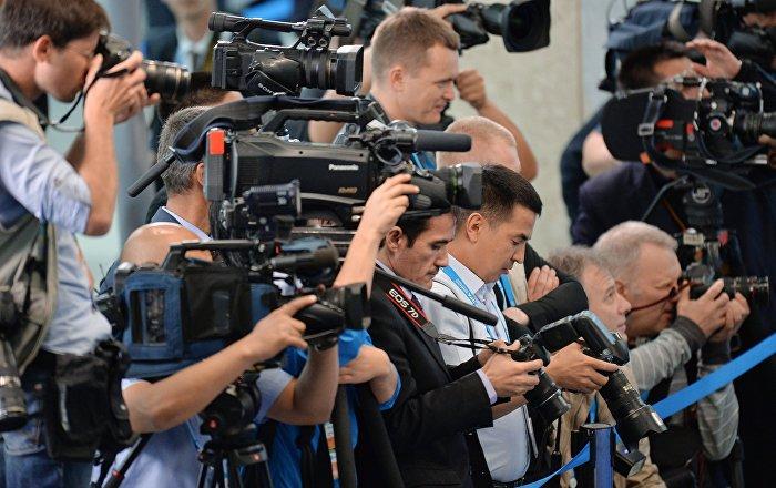 Журналисты на съемке. Архивное фото