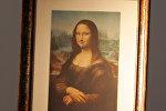 Репродукция Моны Лизы Леонардо Да Винчи авторства французского художника Марселя Дюшана