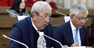 Архивное фото депутата ЖК VI созыва Исхака Масалиева