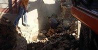 Последствия обрушения дома по улице Памир в Оше