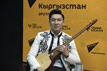 Комузчу Назбек Кенчинбаевдин архивдик сүрөтү