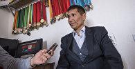 Сегиз баланын атасы Съездбек Таштакеев маек учурунда