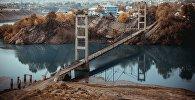Мост Капитальная, которая соединяет город Таш-Кумыр в Джалал-Абадской области. Архивное фото