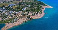 Пляже озера Иссык-Куль. Архивное фото
