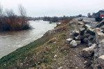 Угроза смыва часть объездной дороги отрезок дороги около Токмока рекой Чу
