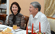 Президент Кыргызстана Алмазбек Атамбаев и первая леди Раиса Атамбаева. Архивное фото