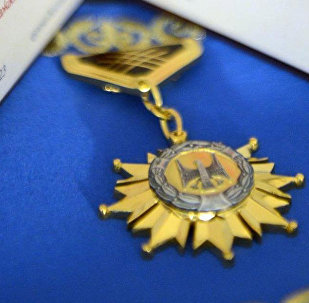 Знак Ак Шумкар — высшая степень отличия Кыргыз Республикасынын Баатыры