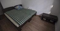 Кровать в комнате. Архивное фото