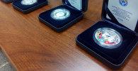 Коллекционная монета Евразийский экономический союз от НБКР. Архивное фото