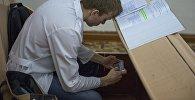 Студент перед началом лекции. Архивное фото