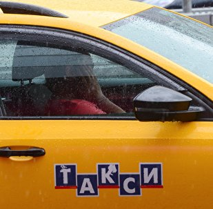 Такси айдоочусу. Архивдик сүрөт