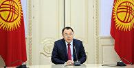 Өкмөттүн аппарат жетекчиси Нурханбек Момуналиевдин архивдик сүрөтү