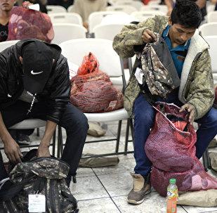 Группа из 228 иммигрантов, депортированных из Соединенных Штатов. Архивное фото