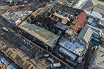 Последствия крупного пожара на территории Ошского рынка в Бишкеке. Вид с дрона