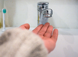 Кран в ванной комнате. Архивное фото
