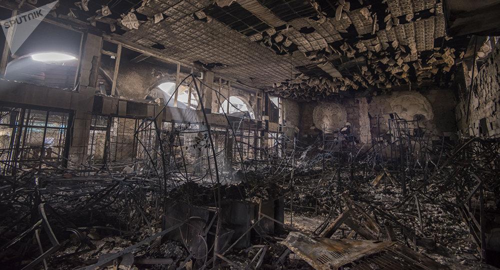 Последствия пожара на Ошском рынке. Архивное фото