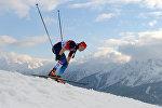 Архивное фото Евгении Шаповаловой (Россия) на дистанции четвертьфинального забега индивидуального спринта в соревнованиях по лыжным гонкам среди женщин на XXII зимних Олимпийских играх