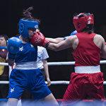 Нелегко поймать момент, когда боксеры одновременно наносят удары