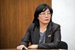 Мамлекеттик каттоо кызматынын төрайымы Алина Шаикова. Архивдик сүрөт