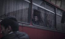 Мигранты в автобусе. Архивное фото