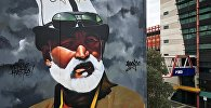 Мельбурнда (Австралия) калпак кийген кыргыз аксакалдын сүрөтү пайда болду