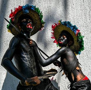 Азыркы замандын карнавалдарынын бири. (Колумбия)
