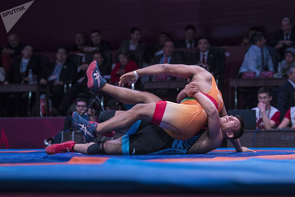 Кореялык балбан индиялык спортчуну оодарып койсо жакшы упай алат