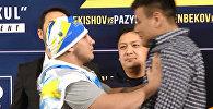 Украинский боец толкнул кыргызстанца на дуэли взглядов в Бишкеке. Видео