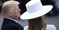 Президент США Дональд Трамп с супругой Меланией перед встречей с главой Франции Эммануэлем Макроном в Вашингтоне. 24 апреля 2018 года
