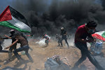 Столкновения палестинцев и израильских военных на границе сектора Газа с Израилем. 14 мая 2018 года