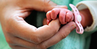 Новорожденный ребенок. Архивное фото