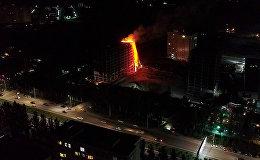 Пожар в недостроенном многоэтажном доме в 12-микрорайоне Бишкека