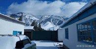 Выпадение снега в селе Сан-Таш Тюпского района