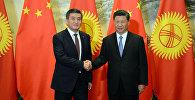 Президент Сооронбай Жээнбеков Кытай төрагасы Си Цзиньпин менен жолугушуу учурунда. Архив