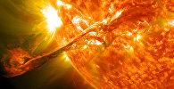 Вспышке на солнце, которая приводит магнитной буре. Архивное фото