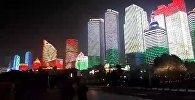 На десятках небоскребов высветился флаг Кыргызстана. Видео из Китая