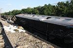 На месте крушения поезда в Жамбылской области Казахстана. 17 июня 2018 года
