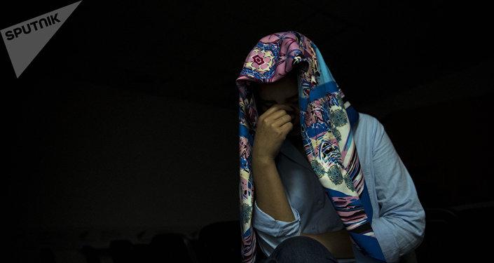 Женщина с платке. Архивное фото