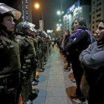 Чили мамлекетинин феминисттери сексуалдык асылууга каршы уюштурулган каршылык акциясында