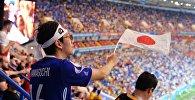 Болельщик сборной Японии во время матча 1/8 финала чемпионата мира по футболу между сборными Бельгии и Японии.