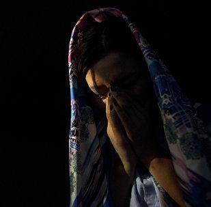 Девушка в платке. Иллюстративное фото